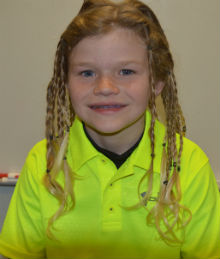 Marshall Elementary fourth-grader Mark Millard grew his hair for 18 months to donate to Wigs 4 Kids of Michigan