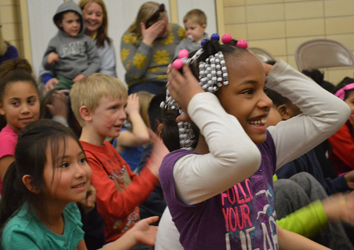 Second-grader Sparkle Murray, and her classmates react to the performanc