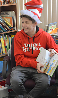 Alexis Sell said she loves to see children's happiness when they receive books