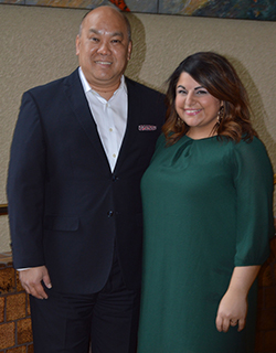 """Norina Cadili stands with George Aquino, vice president and managing director of the Amway Hotel Collection. """"Norina's always been a star from Day One,"""" Aquino said. """"We expect nothing but great things from her, so don't be surprised if she's standing in my shoes soon."""""""