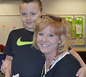 Not many days go by without a hug from Mrs. Slentz for second-grader Reid Glupker