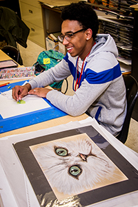 Carlos Sampson works on a drawing during the Honor's Art class