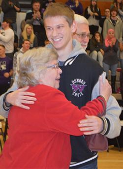 Junior Ryan Huizinga celebrates with his family