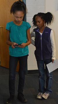 Endeavor Elementary fifth-grader Jaidah Williamson teaches second-grader Kendall Sallie how to program Sphero, a robotic ball