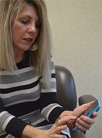 """Valerie Behm, district public relations specialist, says the new Lowell Area Schools app contains information and resources that are """"so meaningful and current, people will want to return"""""""