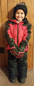 Alexandro Ochoa, a preschooler at Kelloggsville Early Childhood Center, all bundled up in his new winter clothes