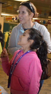 Fourth-grader Yenilka Torres picks out a fuzzy-topped pencil
