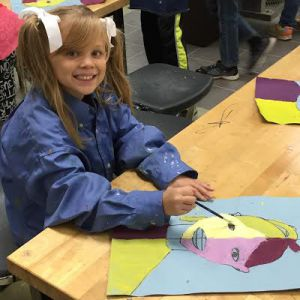 Fourth-grader Natalie Telman with her Henri Matisse-inspired portrait, which she used applied measurement and ratios to create