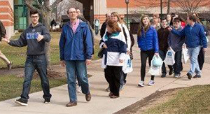 A Grand Valley State University student gives a tour of campus to prospective students and their parents