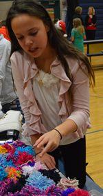 Vivian Lamange sells pompons