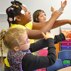 """Students """"arm spell,"""" a multi-sensory approach that helps them remembers sounds"""