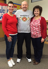 Dale Allers finds a perfect fit working with first grade teachers Megan Taylor (left) and Marcia Powell