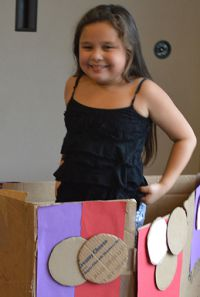Second-grader Irais Gonzalez-Ibarra greeted people from her cardboard house
