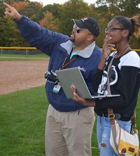 Freshman Shyauna McKinney takes in information about temperature from Kent ISD STEM consultant Ebiri Nkugba
