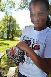 Student Zamora Harris-Tamminga holds her hen friend