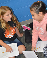 Kendall DuBuis and Sabrina discuss text introduced in a mini-lesson