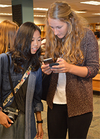 """Nopparet """"Mint"""" Likhithattaslip, from Thailand, exchanges phone numbers with Veronika Rieks, from Germany"""