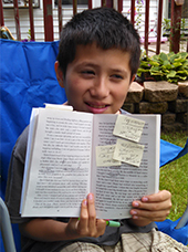 Fifth-grader Dante Botello used sticky notes to demonstrate he was expanding his base of vocabulary words