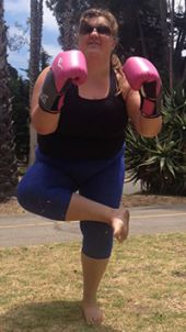 Elizabeth Wisniewski posing in California for a new class she is developing that blends yoga and kickboxing