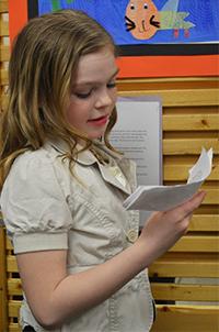 """Third-grader Presley Harrison presents during """"Leaderville"""""""