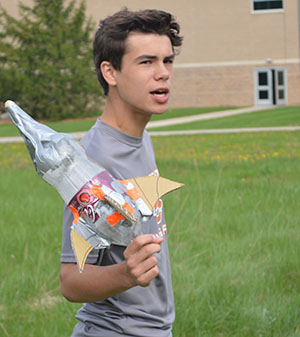 Eighth-grader Michael Fisk gets ready to test his rocket