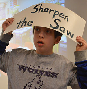 Oriole Park Elementary student Adam Lagerwey reminds students how to be a leader