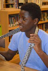 Seventh-grader Justin Jackson practices tying