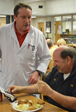 Chemistry teacher Bill Larson chats with Eddie Michalec at the retirement party