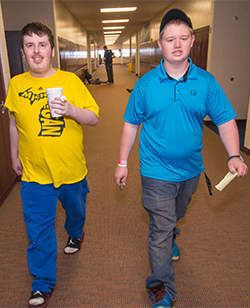A familiar sight in Kenowa High school's halls is Nick Huntington, left, and Carter Zuidema making a delivery run