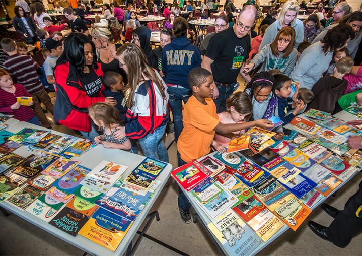 Families gather around the books