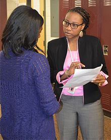 Aliya Armstrong offers advice to Kessia, a senior who has been homeless
