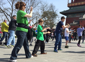 The group from Forest Hills draws a crowd while doing Tai Chi in a Beijing city park