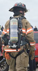 A firefighter assists at the scene