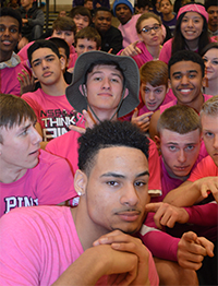 Seniors Darren Dannah (in front) and Mitch Hendrickson (in hat) started the Wolf Pack student section