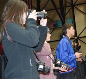Tracking the game action are (from left) graphic communications students Carrie Rister, Abby Downing and Greg Szudzik