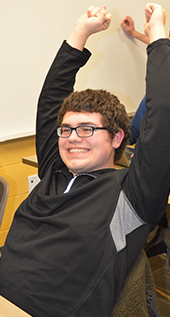 Comstock Park junior Mark Razmus cheers during an Esports Club session