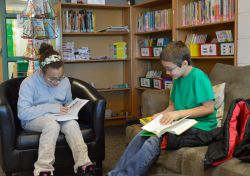 Sierra Stoy (left) and Richard Toris have fun telling each other about their books