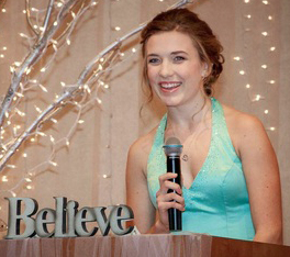 Alicia speaks to guests at a benefit ball she organized -- photo courtesy of Jamie Feldman