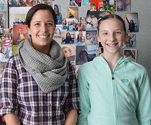 Seventh-grade student Ella Goulet and English teacher Katherine Miller Are inspiring students to read at East Grand Rapids Middle School
