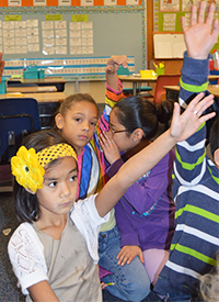 Students raise their hands at North Godwin Elementary School