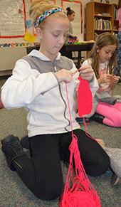 Fourth-grade Breton Downs Elementary student Avery Van Hekken knits