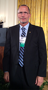 Godfrey-Lee Superintendent David Britten stands in front to the podium at the White House