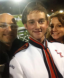 Nathan, with his parents, plays sousaphone in the marching band (courtesy photo)