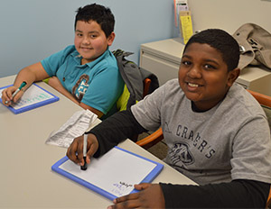 Townline Elementary School fourth-grade students Andrew Rangel-Zavala and Gabriel Toussaint have worked together at tutoring for two years