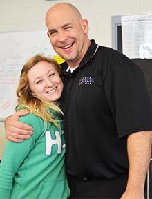 Former Frontiers student Randi Howell hugs Frontiers Program Director Al Vigh