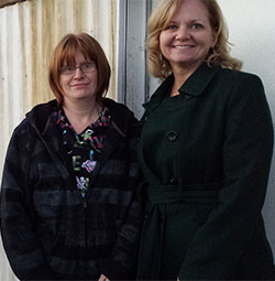 Flossie Bliss, left, gets help in her financial challenges from Jodi West of Kent School Services Network