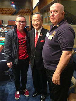 Hayden Sutton with Rotary International President Gary C.K. Huang, center, and district Rotary Interact coordinator Doug Mealey, right