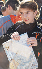 Nickels Intermediate School sixth-grader Ava Dionne holds an old catalog