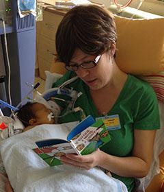 Countryside Elementary School teacher Mandy Liao reads a book to Benjamin