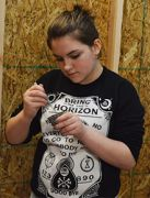 Seventh-grade student Olivia Alonso mixes paint